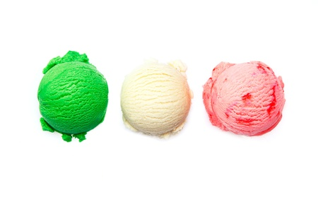 Variety of Italian icecreams with individual scoops of three different flavourings in green , pink and white lined up in a row isolated on white photo