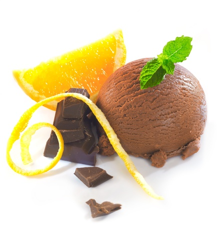 gelato: Delicious chocolate orange combo with chocolate icecream and dark confectionery garnished with mint and fresh orange slices with zest Stock Photo
