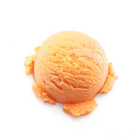 High angle view on a scoop of mango ice cream isolated on white background