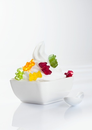 frozen joghurt: Stylish frozen yoghurt with jellybaby topping isolated on white background Stock Photo
