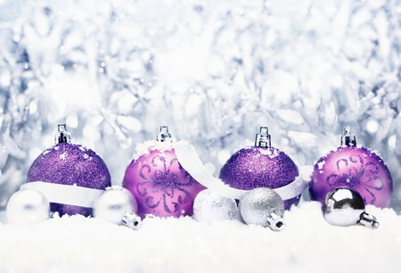 group of christmas baubles: Decorative Christmas greeting with pretty purple baubles with festive silver bow and bokeh