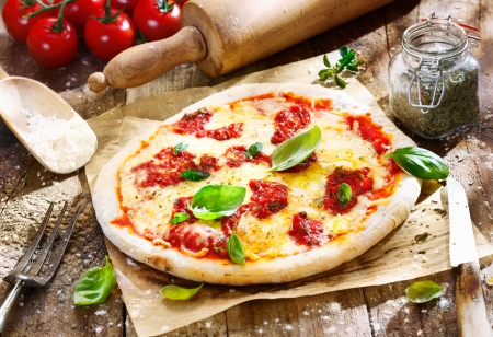 margarita pizza: Original italian Pizza Margherita with cheese and tomato sauce on an old wooden board. For parlour concepts.