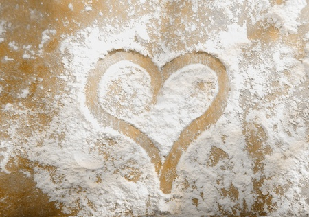 Romantic heart hand drawn in sprinkled flour from your sweetheart on Valentines day or on your anniversary photo