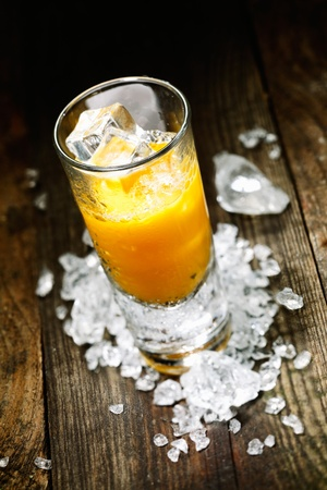 shooter drink: Hard Liquor Orange Juice Shooter on a countertop with crushed ice and alcohol for drink concepts look at my portofolio