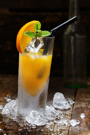 shooter drink: Cool Orange Alcohol Drink with crushed Ice on wooden table for drink concepts