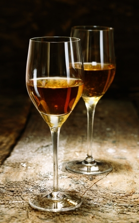 sherry: Two glasses of sherry on brown wooden background