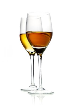 Two glasses of hard liquor aperitif isolated on white Stock Photo - 15513631