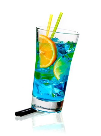 Tall glass of blue blended curacao cocktail with orange slices and ice cubes coneptual of a celebration or a tropical vacation Stock Photo - 15513643