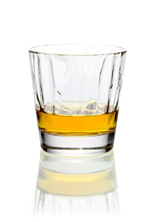 shooter drink: Refreshing relaxing glass of whiskey or brandy in a tumbler on a white background with reflection
