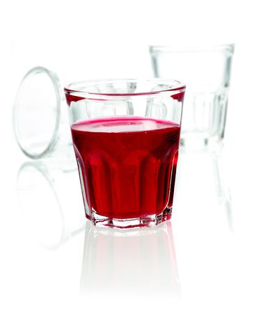 Glass of red rum cocktail blended with fruit juice and soda on a white studio background with copyspace Stock Photo - 15394065