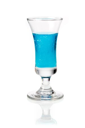 Small sjot glass filled with blue curacao liqueur served as an appetizer or aperitif Stock Photo - 15394048