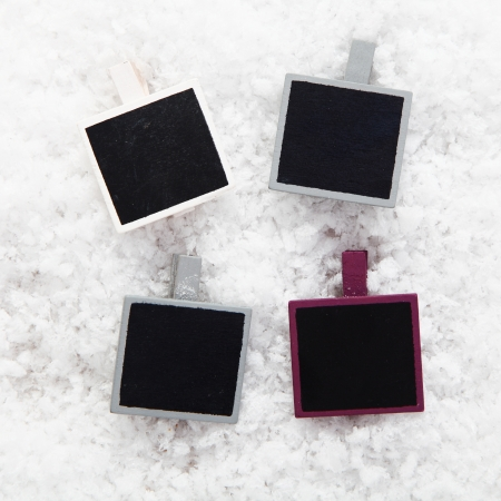 christmas memories: Four empty retro instant photo frames on snow for your collection of Christmas or seasonal images or messages