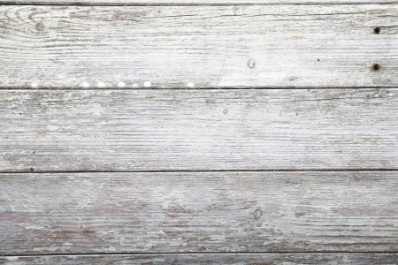 painted wood: Abstract background of weathered wooden plank texture with remnants of old paint, crackes and wood grain