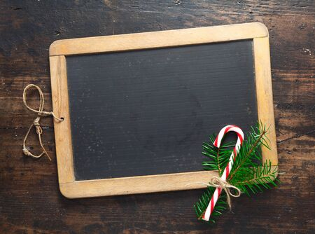 small blank wooden framed chalkboard with a festive candy cane stock photo picture and royalty free image image