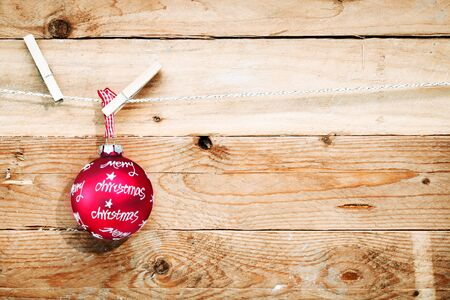 Merry Christmas background with a festive red bauble  photo