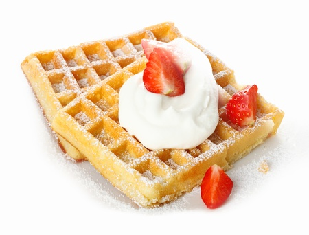 sou: Fresh ripe red strawberries and whipped cream on a crisp golden waffle sprinkled with sugar for a refreshing dessert Stock Photo