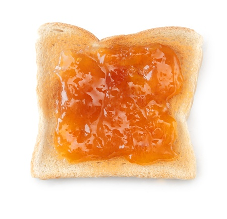 apricot jam: Overhead view of a slice of white toast topped with vibrant orange apricot or peach jam Stock Photo