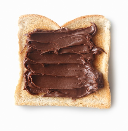 Tasty closeup of a slice of bread with chocolate cream