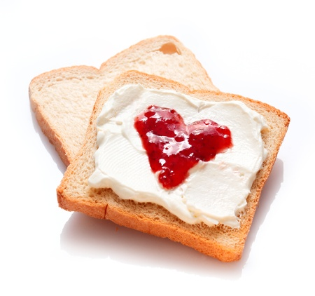 Two tasty slices of bread with jam and butter photo