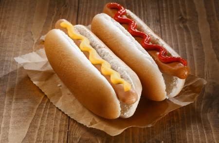 hotdog: Two appetizing hotdogs with mustard and ketchup, close up Stock Photo