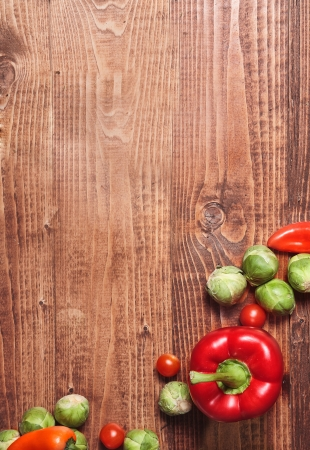 kitchen table: Composition of veggies on wooden table surface Stock Photo