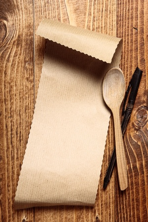 Brown paper on wood with a wooden spoon and a pen Stock Photo - 17853292