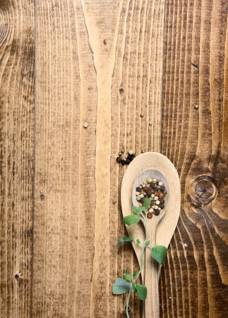 kitchen table top: Wooden spoons on table top with peppercorns Stock Photo