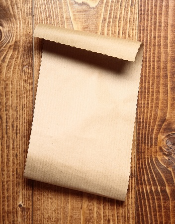 Blank brown paper on a wooden surface Stock Photo - 17853020