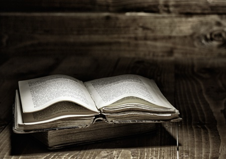 bible backgrounds: Well used open book on wooden table Stock Photo
