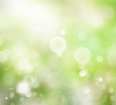 glistening: Relaxing blurred green glowy background with light bubbles