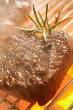 sizzling: Close up shot of meat on the grill barbecue