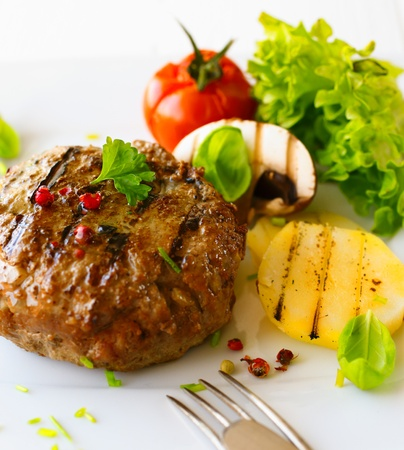 menue: Healthy grilled patty and vegetable in a close up shot