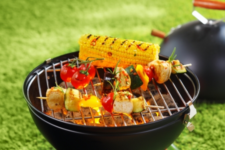 Healthy corncob en brochette on the grill outdoor photo