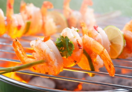 barbecue fire: Close up view of Mexican grilled shrimp on stick