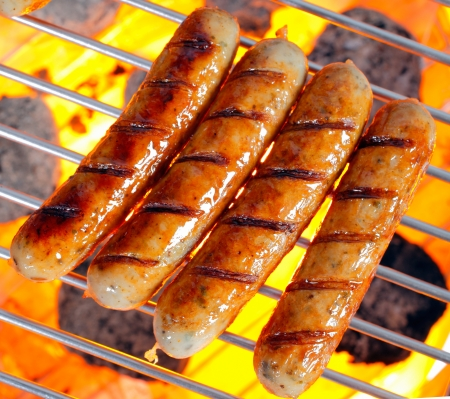Grilled Italian pork sausage on a grilling pan photo