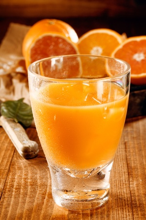 juice bar: A glass with healthy fresh orange and grapefruit juice