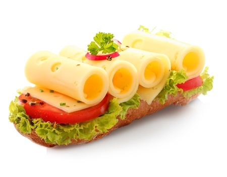 Decorative open baguette sandwich with four slices of rolled cheese on top of fresh lettuce and sliced red tomato on a white background