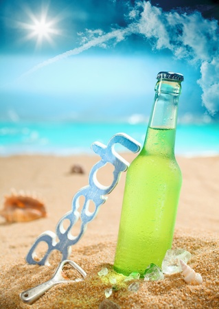 Beautiful composition of chilled beer, beach, bottle opener and amazing sky. Look at my portfolio for more cocktails. photo