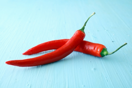 red jalapeno: Two red hot jalapeno chili peppers