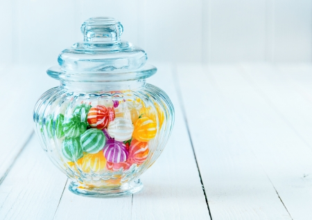 Photograph of a beautiful jar full of assorted colorful candies, perfect for gift purpose. photo