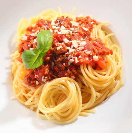 twirled: Beautifully presented spaghetti bolognaise with carefully twirled spaghetti topped with a sauce of tomatoes and minced meat sprinkled with cheese
