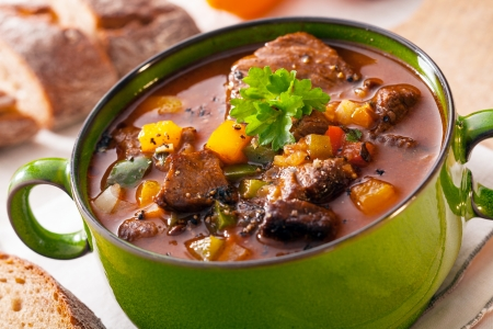 Tasty winter traditional hot pot stew with meat and vegetables stewed in a rich gravy for a wholesome meal on a cold day