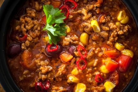 those: Tasty spicy chili con carne casserole closeup in a pot for those cold winter nights, high angle view