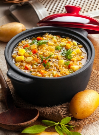 stew: Delicious lentil and vegetable stew in a rustic kitchen in an open crock, high angle view Stock Photo