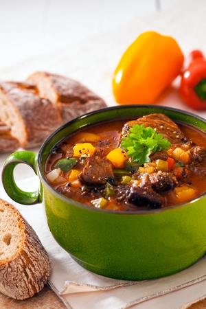 Goulash: Nutritious winter casserole with meat and vegetables in a rich gravy served with slices of bread
