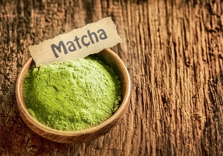raw tea: Matcha powder masde from ground green tea used as a traditional Japanese beverage and as a flavouring and colouring in cooking