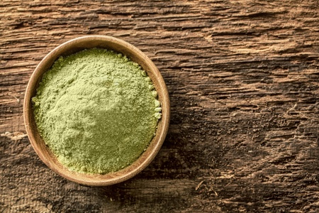 Overhead view of a bowl of finely ground green tea powder, or matcha, used as an Asian beverage especially in Japanese tea ceremonies and also as a flavouring in food