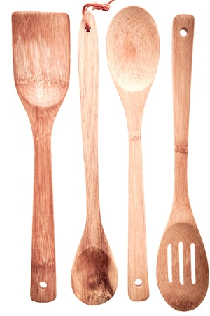 draining: Set of wooden cooking utensils with a spatula, spoon, ladle and draining spoon isolated on a white background