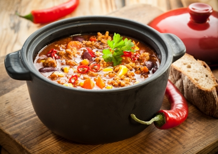 crock pot: Tasty spicy chili con carne casserole in a pot for those winter nights, high angle view
