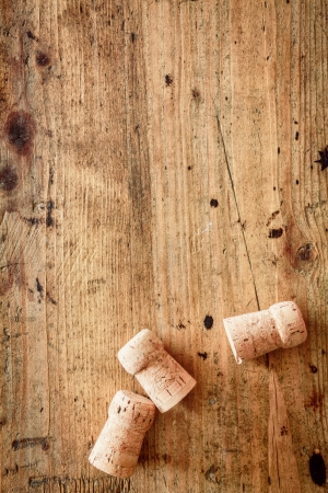 Bottle corks for champagne or wine on a wooden background with copyspace for your festive or New Year greeting Imagens